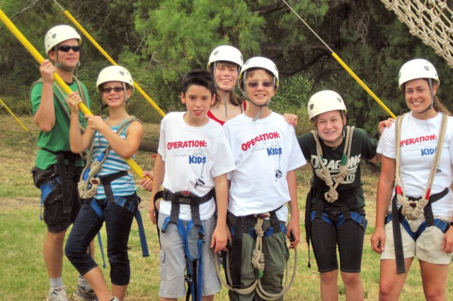 Military youths get ready to conquer the Odyssey Ropes Course during Hawaii Adventure Camp at Camp Erdman, here, recently. From July 21-26, youth will build leadership, self-confidence and teamwork skills while participating in similar adventures.