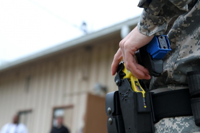A military police officer with Headquarters and Headquarters Company, 3rd Stryker Brigade Combat Team, 2nd Infantry Division, prepares to employ his electronic control device at the Directorate of Emergency Services during the Taser Certification Training course at Joint Base Lewis-McChord, Wash., May 9, 2013. The Soldier was one of 18 military police officers who spent two days in the Taser Certification Training course, where officers learned about the weapon and following classroom training were placed in various situations that required them to quickly react to a variety of aggressive and non-compliant subjects. (U.S. Army photo by Staff Sgt. Lindsey Kibler/Released)