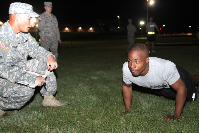 "CAMP BULLIS, Texas "" Spc. Malcolm Knox, Operations Company, U.S. Army North (Fifth Army), makes pumping out push-ups look easy May 13 as Staff Sgt. Charles Ridgeway, Operations Company, Army North, grades him during the Army Physical Fitness Test portion of the Joint Base San Antonio 2013 Noncommissioned Officer and Soldier of the Year ""Best Warrior"" Competition. The event is being held May 13-17 at Camp Bullis and Fort Sam Houston. Knox, originally from Baton Rouge, La., is one of three Army North Soldiers in the competition, which also includes Soldiers from U.S. Army South, U.S. Army Medical Department Center and School, U.S. Army Southern Regional Medical Command and U.S. Army Installation Management Command. Later in the week, the Soldiers will be tested on their ability to successfully complete a multitude of Soldier tasks and skills, such as day and night land navigation, combatives, weapons qualification, an oral board and a written examination. The two other Soldiers from Army North are Staff Sgt. Jason Proefrock, Intelligence and Sustainment Company, Headquarters and Headquarters Battalion, and Staff Sgt. Jason Ruiz, Headquarters Support Company, HHBn."
