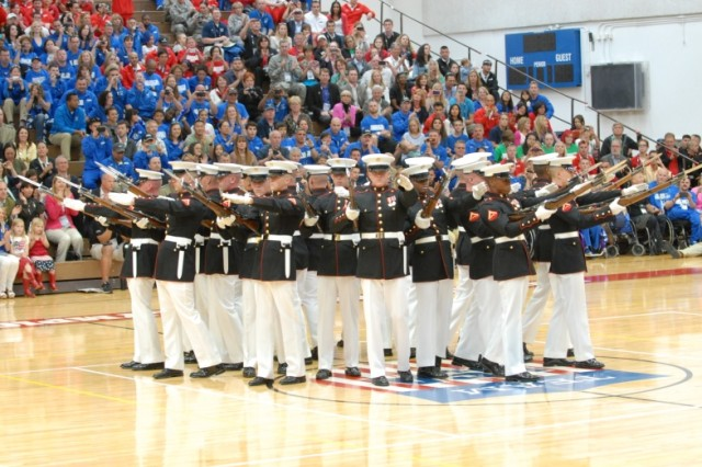 COLORADO SPRINGS, Colo.  -  The United States Marine Corps Silent Drill Team performs at the opening ceremonies for the Warrior Games held at the Olympic Training Center on May 11, 2013.  Hundreds were on hand for the ceremony, including Great Britain's Prince Harry.  The ceremony kicked off a weeklong event that pits more than 260 wounded, ill or injured service members from across the Department of Defense and United Kingdom against each other. The competitions will cover seven sports: archery, cycling, shooting, sitting volleyball, swimming, track and field and wheelchair basketball.  (Photo by U.S. Army Staff Sgt. Brent Powell, 210th Mobile Public Affairs Detachment)