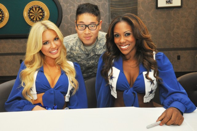 Pfc. Lim Hong-seo, Public Affairs Specialist with USAG Yongsan, was delighted to strike a pose with the Dallas Cowboys Cheerleaders,during a Meet and Greet at the R&R Bar and Grill here, May 10. (U.S. Army photo by Sgt. Kevin Frazier)