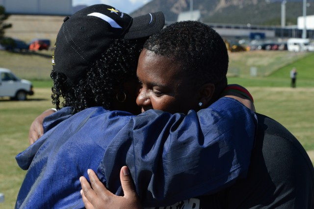 Retired Sgt. Monica Y. Southall gets a hug from her mom, Barbara Southall, May 14, 2013, just moments after she earned gold in the discus event at 2013 Warrior Games, held May 11-16, 2013, at Colorado Springs, Colo.