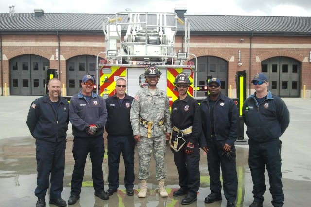 Command Sgt. Maj. James K. Sims, Combined Arms Support Command senior noncommissioned officer, (center), poses with members of Fort Lee's Fire and Emergency Services Department after visiting their facility to observe training.