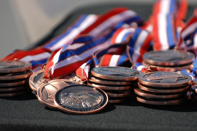 COLORADO SPRINGS, Colo. -   A stack of medals waits to be awarded to athletes at the U.S. Air Force Academy here May 14 during the 2013 Warrior Games. The Warrior Games are a weeklong annual event pitting more than 260 wounded service members from across the Department of Defense and United Kingdom against each other in a goodwill competition. The competitions will cover seven sports: archery, cycling, shooting, sitting-volleyball, swimming, track and field, and wheelchair basketball.  Warrior Games are representative of a great Warrior Care and Transition Program that heals and transitions Soldiers back into the Army or their communities with dignity and self-determination. (U.S. Army photo by Staff Sgt. Brent Powell, 210th Mobile Public Affairs Detachment)