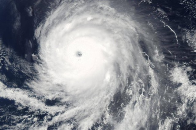 Because of its tremendous size, Hurricane Sandy drove a catastrophic storm surge into the New Jersey and New York coastlines. Preliminary U.S. damage estimates are near $50 billion, making Sandy the second-costliest cyclone to hit the United States, with Hurricane Katrina being the first, according to the National Oceanic and Atmospheric Association.