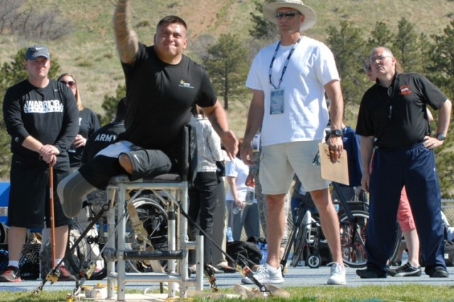 COLORADO SPRINGS, Colo. -   Army Spc. Quinton Picone, an infantryman from McAlester, Okla., assigned to the Fort Sam Houston Warrior Transition Battalion, takes his turn throwing a shot-put during the seated shot-put competition at the Warrior Games held at the U.S. Air Force Academy on May 14, 2013.  The Warrior Games are a weeklong annual event pitting 260 wounded, ill or injured service members from across the Department of Defense and United Kingdom against each other. The competitions will cover seven sports: archery, cycling, shooting, sitting-volleyball, swimming, track and field and wheelchair basketball.  Warrior Games are representative of a great Warrior Care and Transition Program that heals and transitions Soldiers back into the Army or their communities with dignity and self-determination. (Photo by Staff Sgt. Brent Powell, 210th Mobile Public Affairs Detachment)