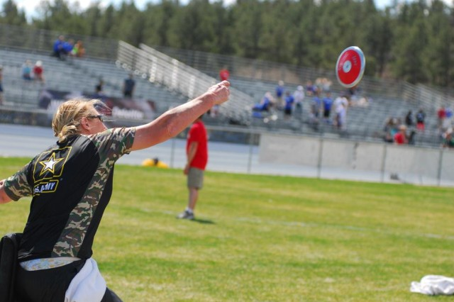 COLORADO SPRINGS, Colo. - Army veteran Chanda Gaeth from La Crosse, Wis., throws the discus during track and field event of the Warrior Games on May 14, 2013. The week-long event began May 11 and pits more than 260 wounded, ill or injured service members from across the Department of Defense and United Kingdom against each other. Service members will compete in track and field, sitting volleyball, shooting, swimming, archery and cycling. The Warrior Games are intended to help service members advance their recovery by helping them overcome challenges associated with their physical injuries or illnesses. (Photo by Sgt. Victor J. Ayala, 210th Mobile Public Affairs Detachment)