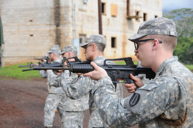 Soldiers execute Military Operations on Urban Terrain training during the 311th Signal Command NCO and Soldier of the Year Competition at Schofield Barracks, Hawaii, May 2-8.
