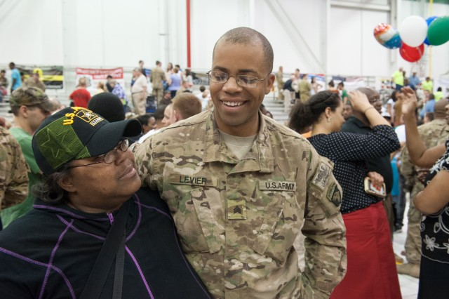 Sgt. Alcone J. Levier, D Company,  5th Battalion, 101st Combat Aviation Brigade, 101st Airborne Division (Air Assault,) shares a joke with his mother, Bonnie Levier, at a welcome home ceremony at Fort Campbell, Ky., May 14, 2013. (U.S. Army photo by Sgt. Duncan Brennan, 101st CAB Public Affairs)