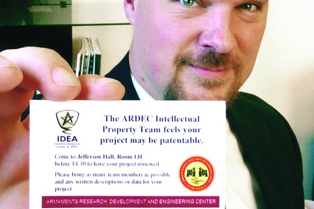 ARDEC engineer Jeffery Lukaszyk shows the business card he would hand out to cadets when their West Point Projects Day presentations passed an initial screening for patent potential. Lukaszyk was a member of a team from Picatinny Arsenal that went to the U.S. Military Academy event because the cadet projects are fertile ground for new, useful and non-obvious innovations that could potentially become U.S. Army intellectual property.