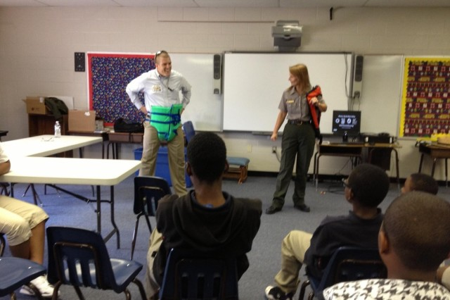 """Public Affairs Specialist Jay Townsend and Outdoor Recreation Planner Chris Smith from the Little Rock District demonstrate how not to wear a life jacket and how dangerous wearing one upside like a diaper could be if a swimmer became unconscious. """"If he fell in the water with his life jacket on like this he would be upside down and could drown,"""" Smith said. One of the very intelligent students from Carver promptly replied with, """"Yeah, cause you can't breathe through your butt!"""" Smith and Townsend visited Carver Magnet Elementary School in Little Rock, Ark., for the school's annual career day May 15. Carver Magnet offers a full-range curriculum, with a focus on science and math that equips children at an early age with the academic and social skills to live in a technical world. The team spoke with 125 students from pre-k to fifth grade about the Corps' past, present and how the students could be part of the Corps' future all while stressing the importance of science, technology, engineering and mathematics."""