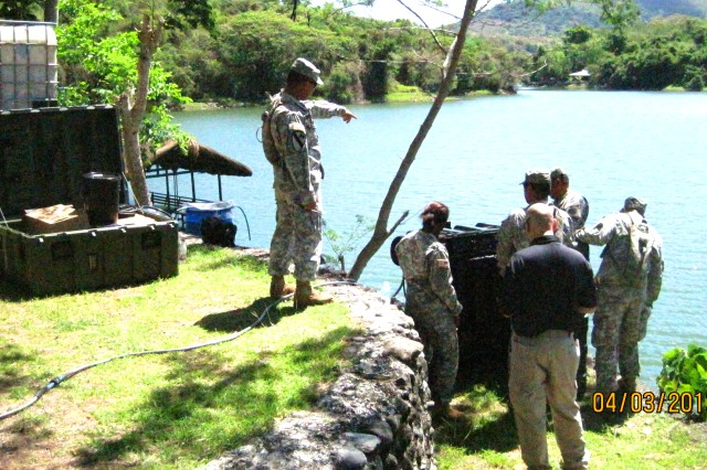 A team of U.S. Army Soldiers and civilians work on Aspen 2000 water-purification systems on April 3.
