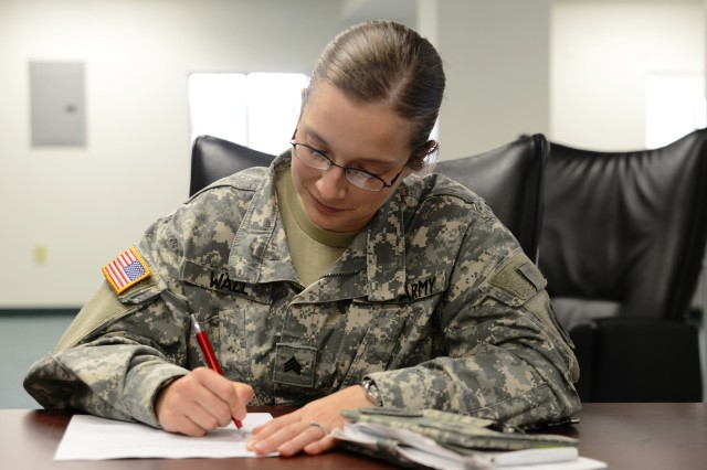 Sgt. Monica Wall, an audio-visual technician with the U.S. Army Pacific Contingency Command Post takes a written exam to test her knowledge during a combat recertification course at Fort Shafter, Hawaii, 10 May.  All Soldiers receive basic first aid training during Army basic training but combat lifesaver training takes that one step further.  Combat lifesavers serve as vital first responders, providing aid to wounded Soldiers.