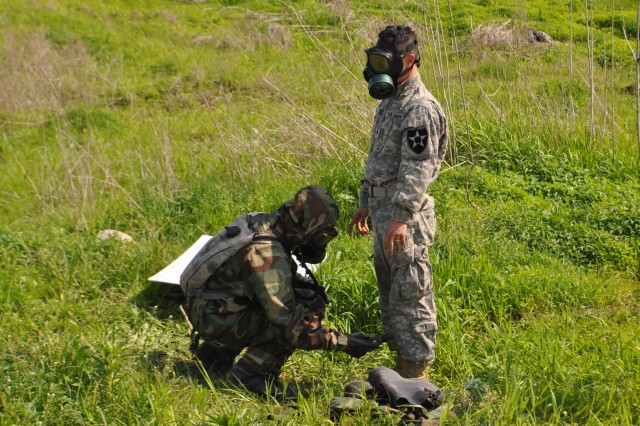 "PAJU, South Korea "" Sgt. Hector Lespier, from Fort Hood, Texas, assigned to A Battery, 1st Battalion, 38th Field Artillery Regiment, 210th Fires Brigade, 2nd Infantry Division, monitors decontamination of his fellow Soldier with the joint chemical agent detector to determine whether he can take the mask off during the decontamination training at Saint Barbara's Training Area in Paju, South Korea, May 13 "" 17, 2013. This event will allow 1st Bn., 38th FA and 23rd Chemical Bn. Soldiers to train with the Republic of Korea Army 9th Division, 26th Regiment, and test their systems and capabilities together to increase their preparedness to respond to chemical, biological, radiological and nuclear threats.  The training is designed to increase readiness to defend the ROK, protect the region, and maintain stability on the Korean peninsula. (U. S. Army photo by Cpl. Kim Han-byeol, 210th Fires Brigade public affairs specialist/Released)."