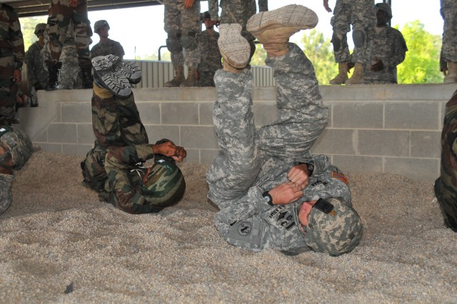Maj. James Bredeman, a USARPAC foreign area officer, practices jump drills with Indian and U.S. Soldiers before loading up on an aircraft and preparing to jump during Yudh Abyhas 2013 held at Fort Bragg, N.C.