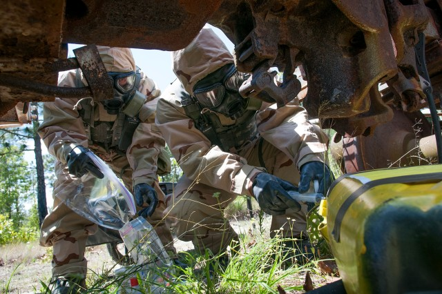 U.S. Army Pfc. Khoa Pham and Pfc. Anthony Williams, hazardous materials specialists with the 82nd Airborne Division's 1st Brigade Combat Team, take a sample of a notional chemical spill during a training exercise with Indian Army soldiers of the 99th Mountain Brigade May 13, 2013, at Fort Bragg, N.C.  The training is part of Yudh Abhyas, an annual bilateral training exercise between the Indian Army and United States Army Pacific, hosted this year by the 82nd Airborne Division's parent organization, XVIII Airborne Corps.  (U.S. Army photo by Sgt. Michael J. MacLeod)