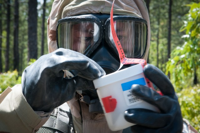 U.S. Army Pfc. Khoa Pham, a hazardous materials specialist with the 82nd Airborne Division's 1st Brigade Combat Team, seals a sample of a notional chemical spill during a training exercise with Indian Army soldiers of the 99th Mountain Brigade May 13, 2013, at Fort Bragg, N.C.  The training is part of Yudh Abhyas, an annual bilateral training exercise between the Indian Army and United States Army Pacific, hosted this year by the 82nd Airborne Division's parent organization, XVIII Airborne Corps.  (U.S. Army photo by Sgt. Michael J. MacLeod)