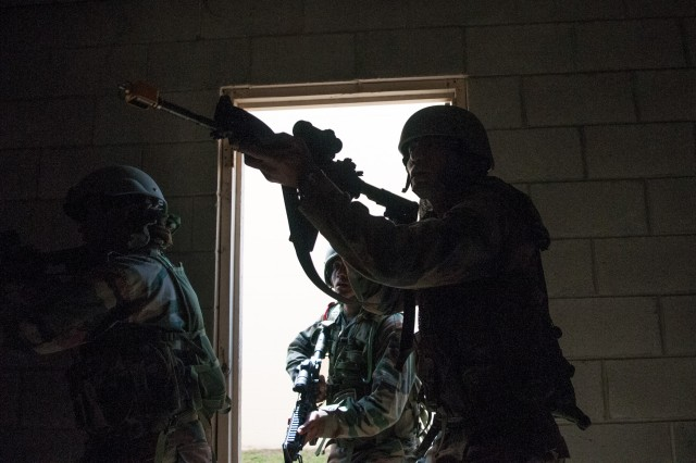 Indian Army soldiers with the 99th Mountain Brigade enter a building to clear it of insurgents during company-level field training with the 82nd Airborne Division's 1st Brigade Combat Team May 13, 2013, at Fort Bragg, N.C.  The training is part of Yudh Abhyas, an annual bilateral training exercise between the Indian Army and United States Army Pacific, hosted this year by the 82nd Airborne Division's parent organization, XVIII Airborne Corps.  (U.S. Army photo by Sgt. Michael J. MacLeod)