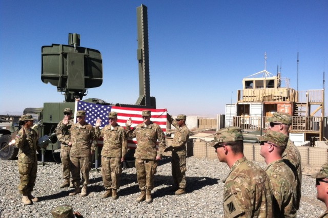 Soldiers from the 3rd Infantry Division re-enlist in front of their new air traffic control system at the Forward Operating Base Wolverine in Afghanistan.