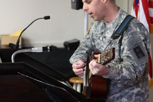 Army Lt. Col. Andrew Doyle, First Army Division East surgeon, sings hymns and discusses historical events that showcase spiritual resilience during the First Army Division East-led prayer breakfast.