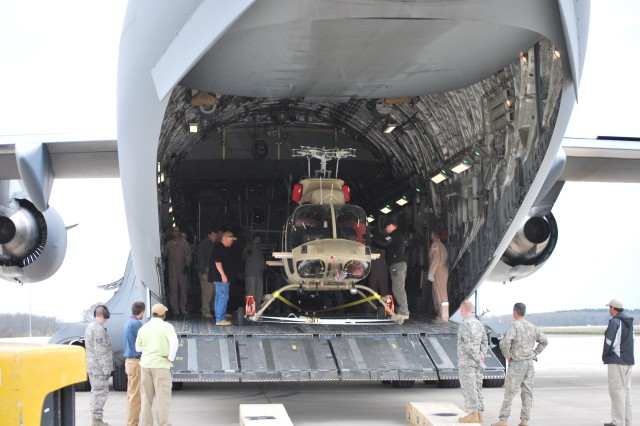 The team finishes loading the last of the three IA-407 helicopters into the C-17, April 3, 2013. This marks the 24th aircraft and final delivery of the armed version of the Bell 407 helicopter.