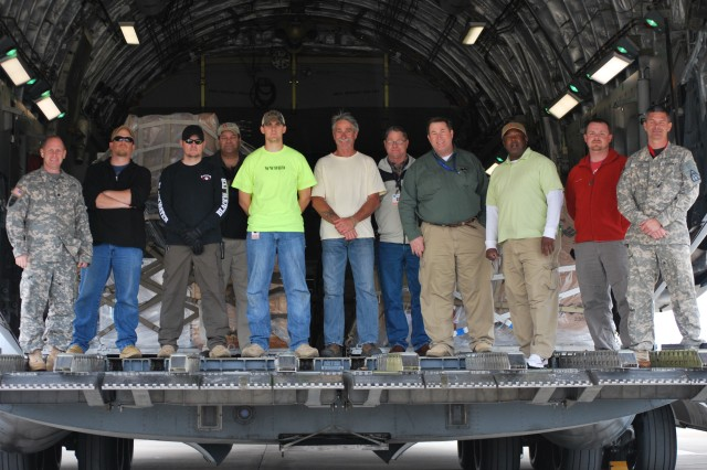 Lt. Col. James Mills (far left) and his team poses for a group photo inside the C-17 just before taking off to deliver three IA-407 helicopters to Iraq.