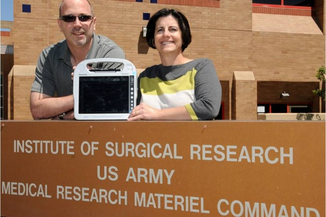 Jose Salinas, Ph.D., Research Task Area program manager for Comprehensive Intensive Care Research, which is part of the U.S. Army Institute of Surgical Research, and Maria Serio-Melvin, MSN, USAISR clinical program coordinator for computer decision support systems and co-chair of the integrated product team that is fielding the Burn Navigator, which recently received 510(k)FDA clearance, display the Burn Navigator.