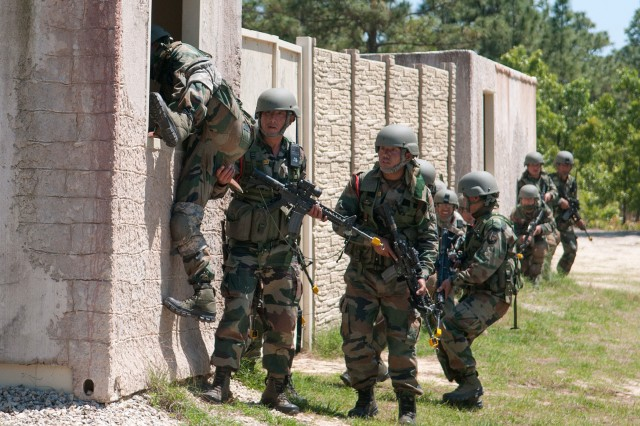 Indian Army paratroopers with the 50th Independent Para Brigade enter a mock insurgent compound during a company-level field exercise with U.S. Army paratroopers of the 82nd Airborne Division's 1st Brigade Combat Team May 14, 2013, at Fort Bragg, N.C.  The training is part of Yudh Abhyas, annual bilateral training between the Indian Army and United States Army Pacific, hosted this year by the XVIII Airborne Corps at Fort Bragg.  (U.S. Army photo by Sgt. Michael J. MacLeod)