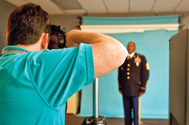 Mike Phillips, Department of the Army photographer, takes the DA studio photo of Command Sgt. Maj. Nathan Hunt, senior enlisted leader, 8th Theater Sustainment Command.