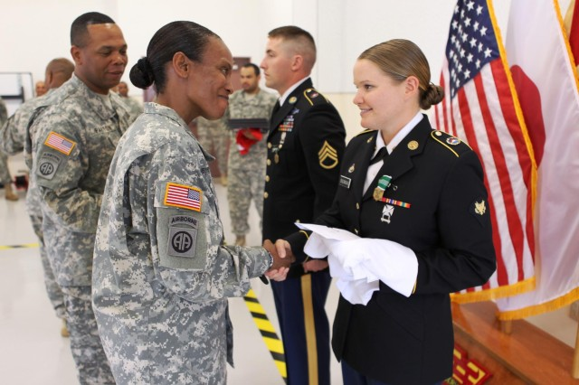 U.S. Army Col. Sheila Bryant, left, the commander of the 10th Regional Support Group congratulates Spc. Mara E. Snowman for being selected as U.S. Army Japan's Soldier of the Year, during a ceremony at Torii Station's Training Support Center in Okinawa, Japan, April 25, 2013. Snowman, a euphonium player assigned to the U.S. Army Japan Band, will move on to compete for the U.S. Army Pacific competition in June. (U.S. Army photo by Sgt. 1st Class Howard Reed/Released)