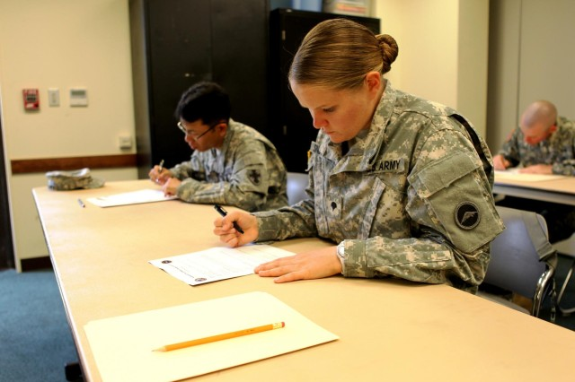Spc. Mara E. Snowman, a euphonium player assigned to the United Stats Army Japan Band, takes a written exam during USARJ's Warrior Challenge Competition April 24th at Torii Station's Chapel Annex. Snowman went on to become USARJ's Soldier of the Year after receiving news about the passing of her grandmother early into the competition.