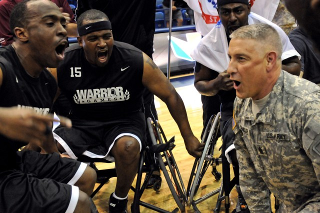 Sgt. Maj. of the Army Raymond F. Chandler III fires up the U.S. Army wheelchair basketball team during a huddle after their victory against the U.S. Air Force team during the 2012 Warrior Games at the U.S. Air Force Academy in Colorado Springs, Colo., May 2, 2012. Chandler was in attendance as the team won the game 57-6. The team are among the 50 disabled, injured or ill soldiers and veterans competing in the Warrior Games for gold in seven sporting events against the Navy, Air Force, Coast Guard, Marines and Special Operations Command and for the Chairman's Cup, an award given to the top-performing service branch.