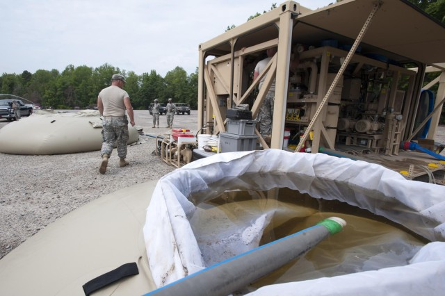 Soldiers with the 741st Quartermaster Company, South Carolina National Guard, purify lake water using the tactical water purification system for Ardent Sentry operations in Barnwell, S.C., May 18, 2013. The unit is participating in a major NORAD and USNORTHCOM sponsored training exercise called Ardent Sentry, May 17-21, 2013.