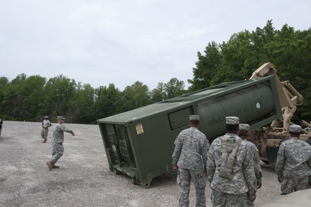 "Soldiers with the 741st Quartermaster Company, South Carolina National Guard unload a water supply tank ""Hippo"" to be filled with purified water for Ardent Sentry exercise operations in Barnwell, S.C., May 18, 2013. The unit is participating in a major NORAD and USNORTHCOM sponsored training exercise called Ardent Sentry, May 17-21, 2013."