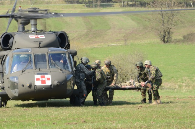 Romanian and U.S. Special Forces Soldiers load a simulated casualty into a medevac helicopter during training at the Grafenwoehr Training Area, Germany, April 24, 2013. The Special Forces Soldiers met for the first time at Grafenwoehr to prepare for missions that require the forces to serve as a combined operational detachment. The Soldiers are with Bravo Company of the 3rd Battalion, Special Forces Group (Airborne), from Fort Carson, Colo. The Joint Multinational Training Command is the U.S. Army's only overseas Training Command and regularly trains U.S., NATO, partnered and allied forces for missions around the world.