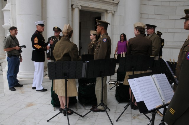 The senior enlisted advisor to the chairman of the Joint Chiefs of Staff, Marine Corps Sgt. Maj. Bryan B. Battaglia, thanks members of the Enduring Freedom Honor Team band from Fredericksburg, Va., after they performed at a ceremony for Armed Forces Day at Arlington National Cemetery, in Arlington, Va., May 18, 2013. (Army News photo by Lisa Ferdinando)