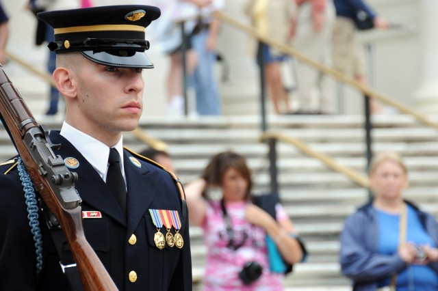 A member of the 3d U.S. Infantry Regiment (The Old Guard) guards the Tomb of the Unknowns at Arlington National Cemetery, in Arlington, Va., following the wreath-laying ceremony for Armed Forces Day, May 18, 2013.