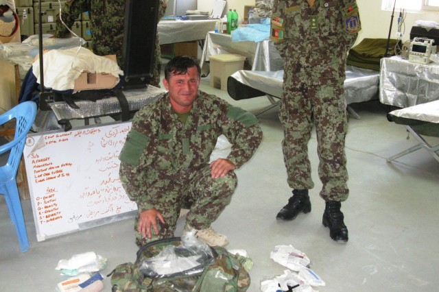 An Afghan National Army medical sergeant assigned to 5th Kandak, 2nd Brigade, 203rd Corps, conducts inventories and restocks his aid bag in his unit's newly established aid station, May 14 at ANA Base Super FOB. Improvements in resupply means improvements in quality of care for injured and wounded Afghan soldiers.