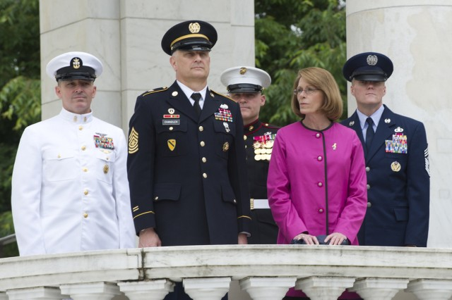 Master Chief Petty Officer of the Navy Mike D. Stevens, Sgt. Maj. of the Army Raymond F. Chandler III, and his wife Jeanne, Marine Corps Sgt Maj Micheal P. Barett and Chief Master Sergeant of the Air Force James A. Cody stand during the playing of the service medley's in honor of Armed Forces Day at the Ampitheater in Arlington National Cemetery, Va., May 18, 2013. President Harry Truman led an effort to establish a day for citizens to come together and thank America's men and women for their patriotic service in support of the nation.