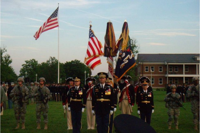 The color guard closes out Twilight Tattoo, surrounded by troops dressed in period uniforms from all eras of U.S. Army history.
