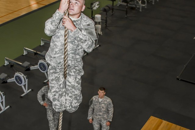 """Spc. Michael McElheny, a native of Fort Long Beach, Fla., and a tanker gunner for Company D, 1st battalion, 30th Infantry Regiment """"Battle Boars"""", 2nd Armored Brigade Combat Team, 3rd Infantry Division, climbs a rope as part of his assessment during the 2nd ABCT's first Pre-Ranger course here April, 24. He is on his third from last day of his assessment, which was over a month long. The course started with 16 candidates but only three others made it as far as McElheny did that day. The course is designed to prepare and to ascertain readiness of soldiers wishing to attend Ranger School. Right now the Army is experiencing a shortage of Rangers, and the founders of this program are hoping that it will increase the successful pass rate of Spartans wanting to go to Ranger School.  (U.S. Army photo by Sgt. Richard Wrigley, 2nd ABCT, 3rd ID, Public Affairs NCO)"""
