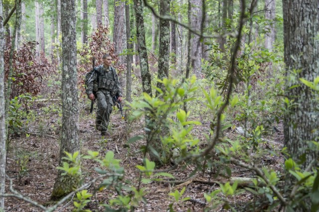 """Spc. Michael McElheny, a native of Fort Long Beach, Fla., and a tanker gunner for Company D, 1st battalion, 30th Infantry Regiment """"Battle Boars"""", 2nd Armored Brigade Combat Team, 3rd Infantry Division, treks through the woods during a graded land navigation course which was part of his assessment during the 2nd ABCT's first Pre-Ranger course here April, 24. He is on his third from last day of his assessment, which was over a month long. The course started with 16 candidates but only three others made it as far as McElheny did that day. The course is designed to prepare and to ascertain readiness of soldiers wishing to attend Ranger School. Right now the Army is experiencing a shortage of Rangers, and the founders of this program are hoping that it will increase the successful pass rate of Spartans wanting to go to Ranger School.  (U.S. Army photo by Sgt. Richard Wrigley, 2nd ABCT, 3rd ID, Public Affairs NCO)"""