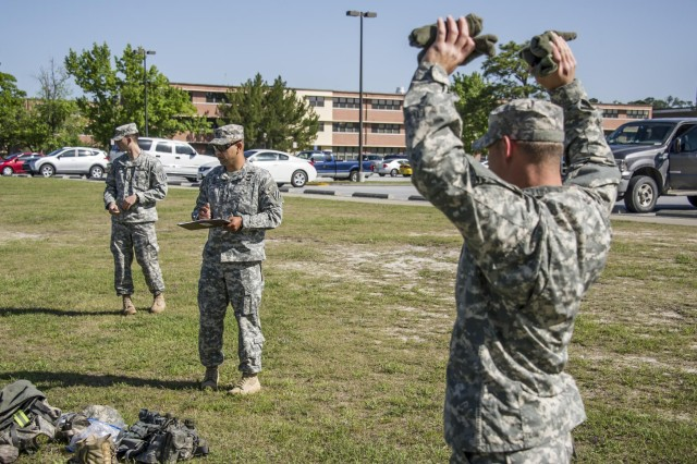 """Sgt. Joseph Messina (right), a native of Cocoa Beach, Fla., and a squad leader within 1st Battalion, 64th Armor Regiment """"Battlekings"""", 2nd Armored Brigade Combat Team, 3rd Infantry Division, holds up some of his gear as Staff Sgt. Pedro Ortiz, a squad leader from the 1st battalion, 30th Infantry Regiment """"Battle Boars"""", inspects to make sure he has everything he needs for the upcoming Field Training Exercise which is the final part of his assessment during the 2nd ABCT's first Pre-Ranger course here April, 24. He is on his third from last day of his assessment, which was over a month long. The course started with 16 candidates but only three others made it as far as Messina did that day. The course is designed to prepare and to ascertain readiness of soldiers wishing to attend Ranger School. Right now the Army is experiencing a shortage of Rangers, and the founders of this program are hoping that it will increase the successful pass rate of Spartans wanting to go to Ranger School.  (U.S. Army photo by Sgt. Richard Wrigley, 2nd ABCT, 3rd ID, Public Affairs NCO)"""