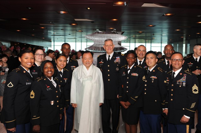 Eighth Army Commanding General Lt. Gen. John D. Johnson (center) and Scholar Ha Yeon-soon stand with U.S. Soldiers at the fourth annual Korean Cultural Night, May 17, 2013.