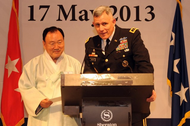 Eighth Army Commanding General Lt. Gen. John D. Johnson (right) and Scholar Ha Yeon-soon speak at the fourth annual Korean Cultural Night,  May 17, 2013..