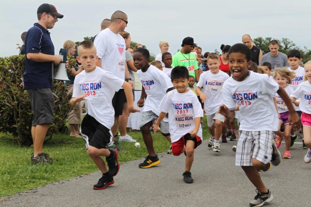 Military children assigned to Okinawa, Japan, bolt from the starting line during the America's Armed Forces Kids Run held May 18 at Kadena Air Base. This is an annual race on all Air Force installations in celebration of Armed Forces Day.