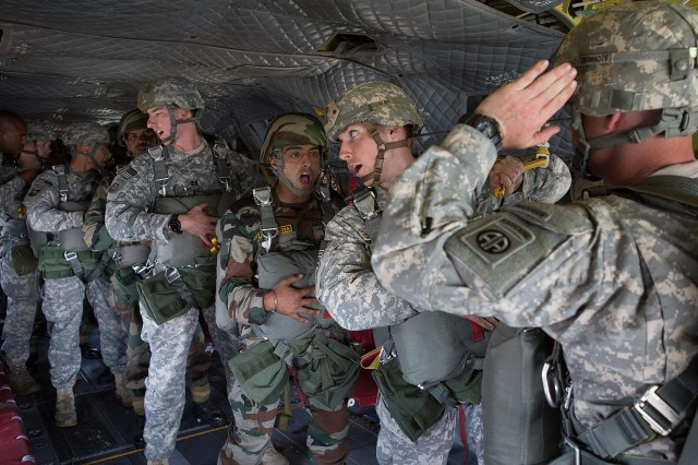 Indian Army paratroopers with the 50th Independent Para Brigade and U.S. Army paratroopers with the 82nd Airborne Division's 1st Brigade Combat Team verify to the jumpmaster that their equipment is ready before exiting a CH47 Chinook helicopter during an airborne operation May 15, 2013, at Fort Bragg, N.C.  The training is part of Yudh Abhyas, annual bilateral training between the Indian Army and United States Army Pacific, hosted this year by the division's parent organization, the XVIII Airborne Corps.  (U.S. Army photo by Sgt. Michael J. MacLeod)