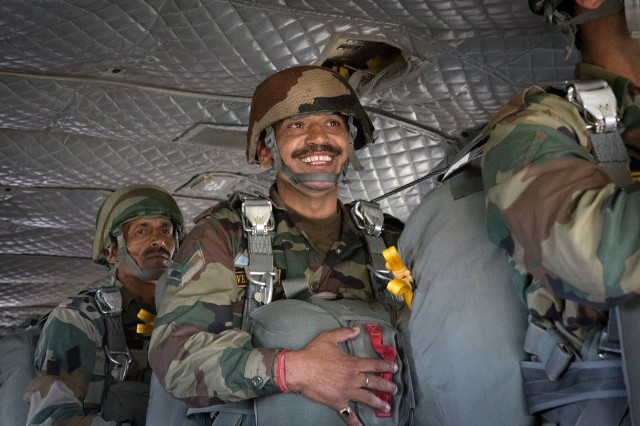 An Indian Army paratrooper smiles before jumping from a CH47 Chinook helicopter with paratrooper from the 82nd Airborne Division's 1st Brigade Combat Team during an airborne training operation May 15, 2013, at Fort Bragg, N.C.  The training is part of Yudh Abhyas, annual bilateral training between the Indian Army and United States Army Pacific, hosted this year by the division's parent organization, the XVIII Airborne Corps.  (U.S. Army photo by Sgt. Michael J. MacLeod)