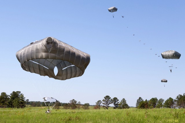 U.S. Army paratroopers with the 82nd Airborne Division using the Army's new T11 parachutes land on St. Mere Eglise drop zone during an airborne training operation May 15, 2013, at Fort Bragg, N.C.  Also jumping were paratroopers with the Indian Army's 50th Independent Para Brigade, visiting Fort Bragg for the first time as part of Yudh Abhyas, annual bilateral training between the armies of India and the United States.  (U.S. Army photo by Sgt. Michael J. MacLeod)