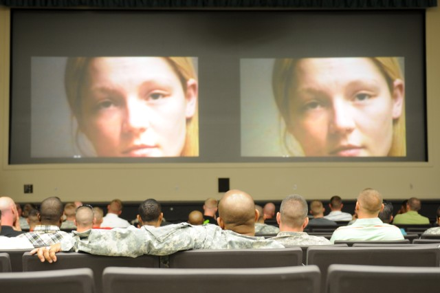 Soldiers from the 3d ESC HHC watch a video describing the dangers of texting and driving during safety summer training May 17 at Haszard Auditorium. The training covered a total of seven topics including motorcycle safety and suicide prevention. (U.S. Army photo by Sgt. Justin A Silvers)
